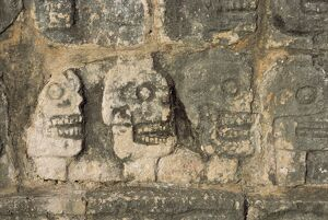 Carvings of skulls on the Tzompantli
