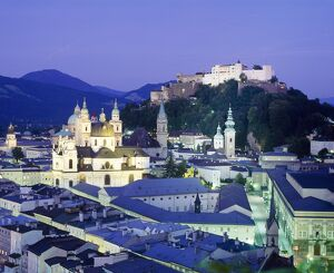 The cathedral and fortress illuminated at night in the town of Salzburg