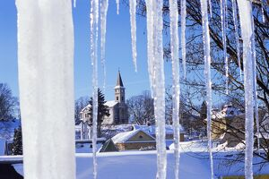 Catholic church in village of Luceny nad Nisou, Jizerske mountains, seen through icicles