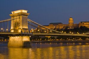The Chain Bridge (Szechenyi Lanchid), over the River Danube, illuminated at sunset
