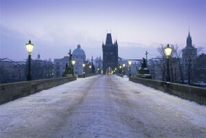 Charles Bridge in winter snow, Prague, UNESCO World Heritage Site, Czech Republic, Europe