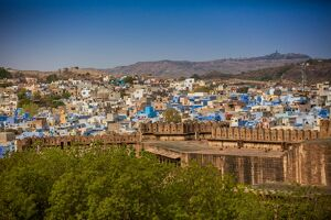 city wall mehrangarh fort towering blue rooftops