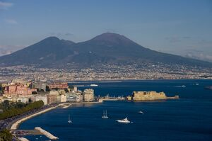 Cityscape including Castel dell Ovo and Mount Vesuvius, Naples, Campania, Italy, Europe
