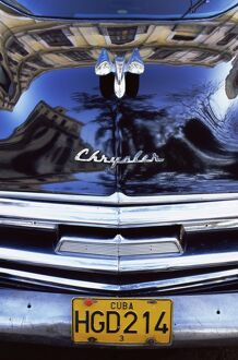 Detail of classic black Chrysler car with reflections in paintwork, Havana