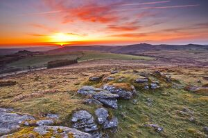 A colourful dawn on Chinkwell Tor in Dartmoor National Park, Devon, England, United Kingdom