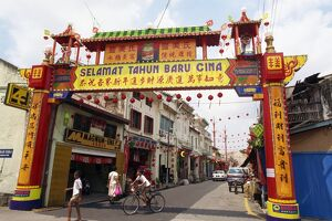 Colourful gateway and street scene in the town of Malacca in Malaysia