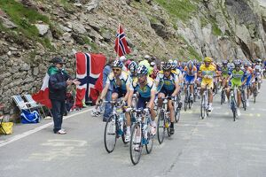 Cyclists including Lance Armstrong and yellow jersey Alberto Contador in the Tour