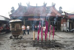Devotional incense sticks burning outside the Goddess of Mercy Chinese temple