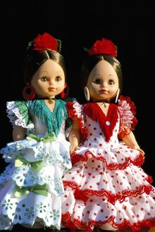 Two dolls dressed in Spanish costume
