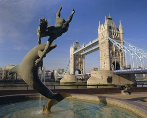 Dolphin sculpture and Tower Bridge, London, England, UK