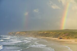 Double rainbow after storm at Carrapateira Bordeira beach, Algarve, Portugal, Europe