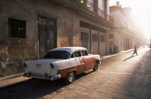 Early morning street scene with classic American car, Havana, Cuba, West Indies