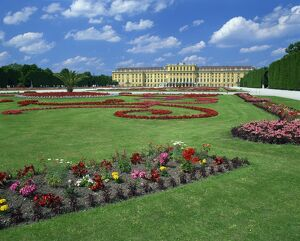 Formal gardens with flower beds in front of the Schonbrunn Palace, UNESCO World Heritage Site