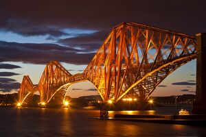 Forth Rail Bridge over the River Forth illuminated at night, South Queensferry, Edinburgh