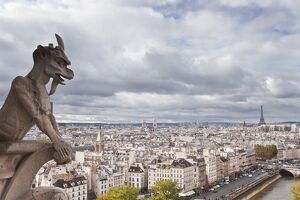 A gargoyle on Notre Dame de Paris cathedral keeping a watchful eye over the city below