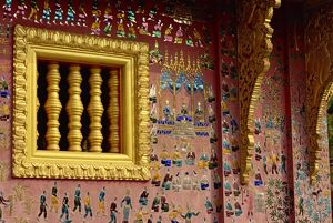 Gilded wooden window and decorated wall of the Wat