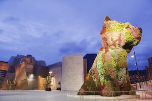 The Guggenheim, designed by architect Frank Gehry, and Puppy, the dog flower sculpture by Jeff Koons, Bilbao, Basque country,