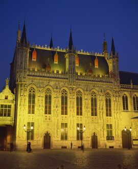 The illuminated facade of the Town Hall in Burg Square in Bruges, at night