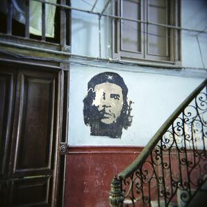 Image of Che Guevara on wall outside apartment, Havana, Cuba, West Indies