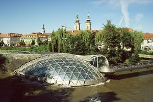 "Island in the Mur River (Murinsel), walkways to an ""Open Mussel"" Theatre Space - Amphitheatre, architect Vito Acconci, Graz, Styria,"