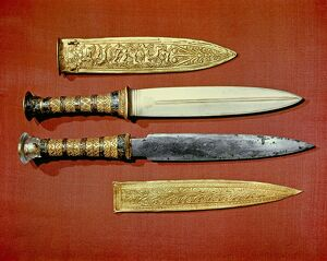 The king's two daggers, one with a blade of gold, the other of iron