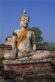 Large statue of the seated Buddha outdoors
