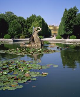 Lily pond and Naiad fountain in the garden of the Schonbrunn Palace, UNESCO World Heritage Site