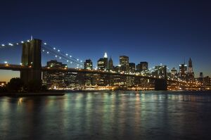Manhattan skyline and Brooklyn Bridge at dusk