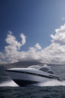 Motor yacht with Mount Vesuvius behind, Bay of Naples, Campania, Italy