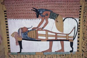 Mural showing the god Anubis leaning over mummy of Ramses II, in the Tomb of Sinjin
