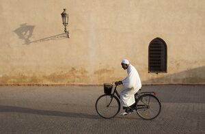 muslim man dressed white bicycle old quarter medina
