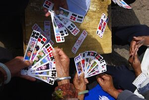 naxi women playing local game cards lijiang yunnan