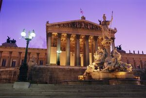 Pallas Athene (Athena) Fountain and Parliament building at night, Vienna, Austria, Europe