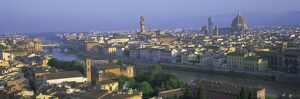Panoramic view over rooftops and across Arno River