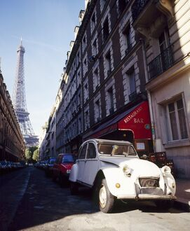 Parked Citroen on Rue de Monttessuy, with the Eiffel Tower behind, Paris