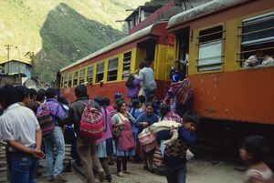Passengers leaving and boarding the train at the railway