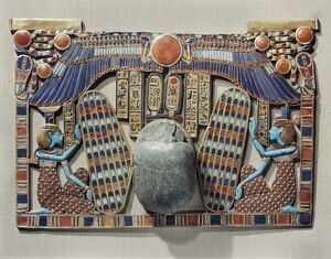 Pectoral decorated with winged scarab, protected by the goddesses Isis and Nephthys