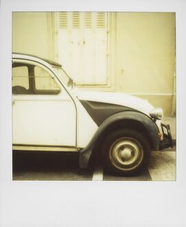 Polaroid of old black and white Citroen 2CV parked on street, Paris, France, Europe