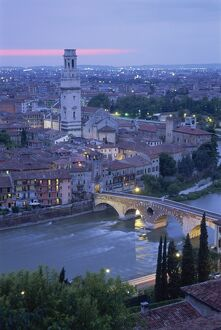 The Ponte Pietra and Anastasia Cathedral at dusk from