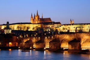 Prague Castle on the skyline and the Charles Bridge over the River Vltava
