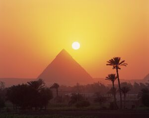 Pyramid silhouetted at sunset, Giza, UNESCO World Heritage Site, Cairo