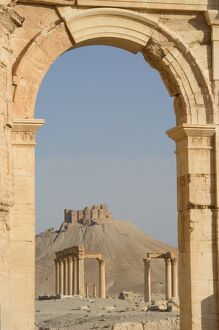 Qala'at ibn Maan Citadel Castle seen through monumental arch
