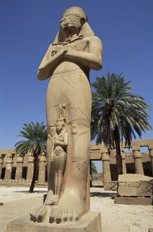 Ramses II and daughter Bant Anta, in forecourt of the temple of Karnak