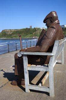 Ray Lonsdale sculpture of a Man on a Bench in North Bay, Scarborough, North Yorkshire