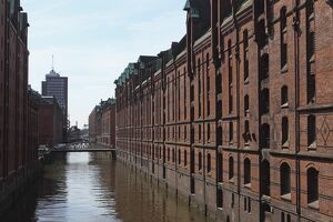 red brick warehouses overlook canal speicherstadt