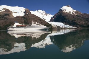 Reflections of the Seabourn Pride cruise ship, mountains and glacier in Chilean Fjordland