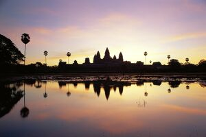 Reflections in water in the early morning of the temple of Angkor Wat at Siem Reap