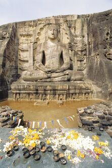 Seated Buddha statue with offerings