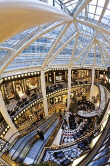 Spiral staircase and decorative floor tiles in luxury shopping centre, Quartier 206