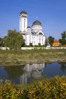 St. Treime Orthodox church on the banks of the river Tarnava Mare in the medieval citadel town